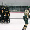Record-Eagle/Keith King<br /> Traverse City Central celebrates after scoring a second-period goal as Traverse City West's Zak Myers skates past Saturday, November 27, 2010 at Centre Ice Arena.