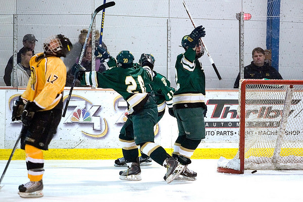 Record-Eagle/Jan-Michael Stump<br /> Traverse City West players celebrate a goal in the third period of Wednesday's win over Traverse City Central at Howe Arena.