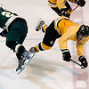 Record-Eagle/Jan-Michael Stump<br /> Traverse City West forward Nick VandeKieft (24) and Traverse City Central forward Joe Tuck go sprawling after a mid-ice collision in the second period Wednesday at Howe Arena.