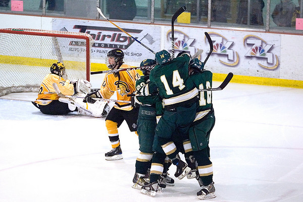 Record-Eagle/Jan-Michael Stump<br /> Traverse City West players celebrate forward Nick VandeKieft's (24) goal in the second period against Traverse City Central Wednesday at Howe Arena.