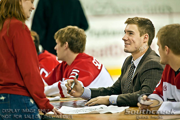 Miami (OH) University's Left Defenseman Will Weber (#4), sporting over 100 stitches and a dozen surgical staples in his neck, signs autographs at the teams autograph session following their overtime shoot at Miami University's Steve Cady Arena at the Goggin Ice Center in Oxford, Ohio, Saturday evening October 30, 2010. The Miami University Redhawks defeated the Lake Superior State University Lakers in a shoot out to end the 2010 regular season CCHA game.  Weber will sit out a large part of the season as he recuperates from the near fatal skate cutting accident during last weeks game against Northern Michigan.  (© James D. DeCamp / Southcreek Global Media)  | All Rights Reserved  | http://www.southcreekglobal.com | For all sales contact: sales@southcreekglobal.com | 1-800-934-5030
