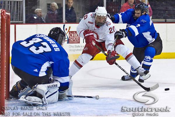 Ohio State University's Forward C.J. Severyn (#20) takes a shot on goal against University of Alabama-Huntsville Goaltender Clarke Saunders (#33) while fending off University of Alabama-Huntsville Defenseman Ryan Burkholder (#2) in the second period of play at the Value City Arena in The Jerome Schottenstein Center in Columbus, Ohio Friday evening November 5, 2010. The Buckeyes lead the Chargers 2-1 at the end of the second period.  (© James D. DeCamp / Southcreek Global Media)  | All Rights Reserved  | http://www.southcreekglobal.com | For all sales contact: sales@southcreekglobal.com | 1-800-934-5030