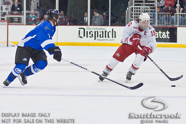 Ohio State University's Forward John Albert (#15) and University of Alabama-Huntsville Forward Jamie Easton (#7) in the second period of play at the Value City Arena at The Jerome Schottenstein Center in Columbus, Ohio Friday evening November 5, 2010. The Buckeyes defeated the Chargers 6-2.  (© James D. DeCamp / Southcreek Global Media)  | All Rights Reserved  | http://www.southcreekglobal.com | For all sales contact: sales@southcreekglobal.com | 1-800-934-5030