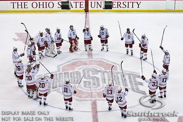Ohio State University's hockey players rally around the logo after the third period of play at the Value City Arena in The Jerome Schottenstein Center in Columbus, Ohio Friday evening November 5, 2010. The Buckeyes defeated the Chargers 6-2.  (© James D. DeCamp / Southcreek Global Media)  | All Rights Reserved  | http://www.southcreekglobal.com | For all sales contact: sales@southcreekglobal.com | 1-800-934-5030