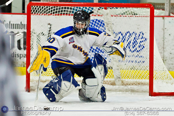 Gahanna High School's Joe Slyman (30) watches the puck in the second period of play against the DeSales High School's Sunday afternoon December 18, 2011 at the Easton Chiller. (© James D. DeCamp | http://www.JamesDeCamp.com | 614-367-6366)