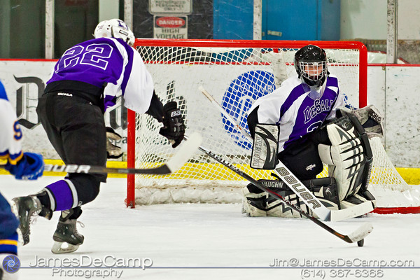 DeSales High School's Goalie Ben Risinger (32) watches as teammate Kyle Ghiloni takes control of a loose puck in the first period of play against Gahanna Sunday afternoon December 18, 2011 at the Easton Chiller. (© James D. DeCamp | http://www.JamesDeCamp.com | 614-367-6366)
