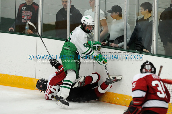 #15 BEN MONCHAMP#34 BLAKE MANNING Edina Hornets vs. Centennial Cougars Junior Varsity HockeyOrder a photo print of any photo by clicking the 'Buy' link above.   TIP: Click the photo above to display a larger size