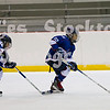 The Oilers squirt travel team played during the first intermission.