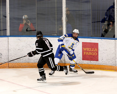 UAF 14 Morley sets to center the puck from behind the UNO red line
