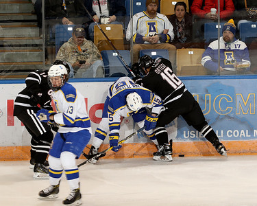 UNO 16 Ortega and UAF 15 Van Tetering battle on the boards for the puck