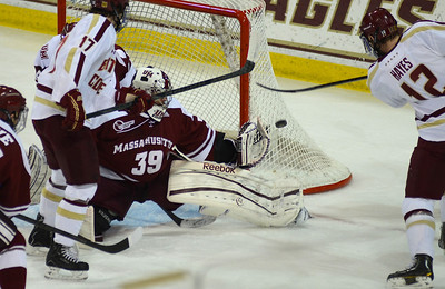 011813, Boston, MA - Boston College's Kevin Hayes (12) bangs the puck off the pipe as UMass' Steve Mastalerz tries to defend the net during Friday's game against UMass Amherst. Herald photo by Ryan Hutton