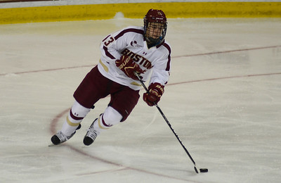011813, Boston, MA - Boston College's Johnny Gaudreau, (13) brings the puck down the ice during Friday's game against UMass Amherst. Herald photo by Ryan Hutton