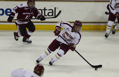 011813, Boston, MA - Boston College's Quinn Smith (27) brings the puck down the ice during Friday's game against UMass Amherst. Herald photo by Ryan Hutton