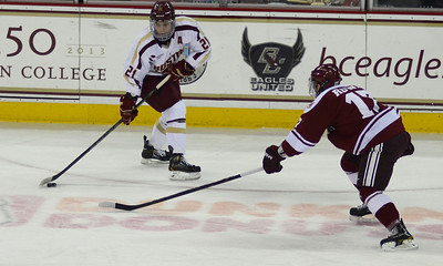 011813, Boston, MA - Boston College's Steven Whitney (21) brings the puck down the ice against UMass' Darren Rowe (17) during Friday's game against UMass Amherst. Herald photo by Ryan Hutton