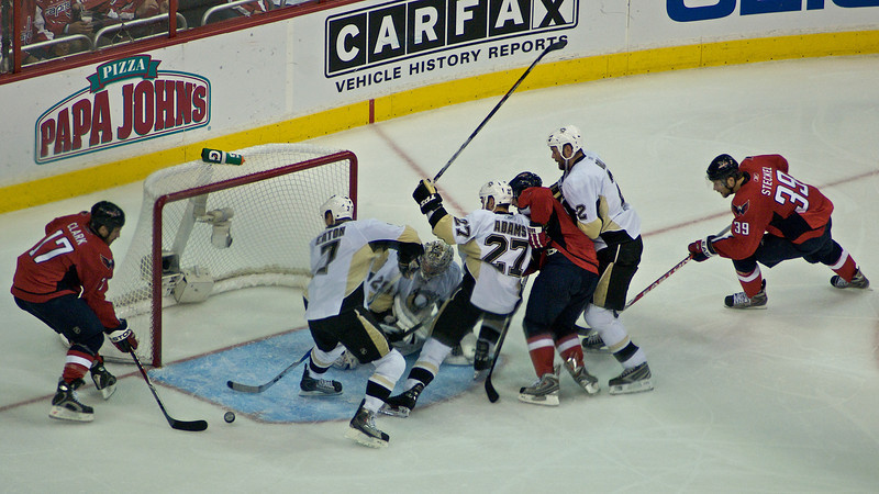 Chris Clark is unable to get the puck in past Eaton. Washington Capitals vs Pittsburgh Penguins Stanley Cup Playoffs Round 2 Game 7 at the Verizon Center, May 14, 2009