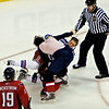 Caps vs Rangers; Washington's Alexander Semin (#28) and NY's Marc Staal (#18) fight in the third period at the Verizon Center