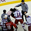 "Caps vs Rangers; Washington's Alexander Semin (#28) and NY's Marc Staal (#18) fight in the third period at the Verizon Center. Pointing may indicate ""look no fighting strap"""