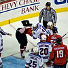 Caps vs Rangers; Washington's Alexander Semin (#28) and NY's Marc Staal (#18) fight in the third period at the Verizon Center. Semin's jerzy comes off with his pads
