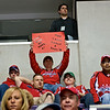 "A Fan holds a sign: ""Great Now we Have 4! Moe, Larry, Curly & Sean (Avery) #16. Washington Capitals face the New York Rangers in a must win Eastern Conference Quarterfinals Game Five at the Verizon Center in Washington DC (April 24, 2009)"