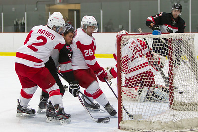 Jeff Hayes sandwiched after scoring
