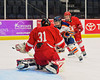 Syracuse University Orange Julie Knerr (3) has her shot blocked by Cornell Big Red goalie Paula Voorheis (31) in NCAA Women Ice Hockey action at the Onondaga County War Memorial on Tuesday, December 3, 2013.