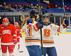 Syracuse University Orange Margot Scharfe (19) is congratulated by her teammate Allie LaCombe (9) after scoring a goal against the Cornell Big Red in NCAA Women Ice Hockey action at the Onondaga County War Memorial on Tuesday, December 3, 2013.