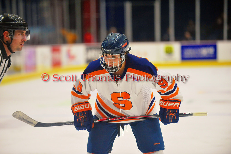 Syracuse University Orange Allie LaCombe (9) getting ready for a face-off against the Cornell Big Red in NCAA Women Ice Hockey action at the Onondaga County War Memorial on Tuesday, December 3, 2013.