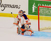 Syracuse University Orange goalie Kallie Billadeau (32) makes a save against the Cornell Big Red in NCAA Women Ice Hockey action at the Onondaga County War Memorial on Tuesday, December 3, 2013.