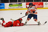 Syracuse University Orange Melissa Piacentini (14) goes after a loose puck with Cornell Big Red Jilian Saulnier (19) in NCAA Women Ice Hockey action at the Onondaga County War Memorial on Tuesday, December 3, 2013.
