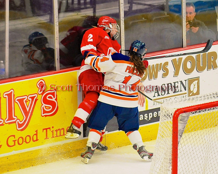 Syracuse University Orange Milissa Placentini (14) checks Cornell Big Red Alyssa Gagliardi (2) in NCAA Women Ice Hockey action at the Onondaga County War Memorial on Tuesday, December 3, 2013.