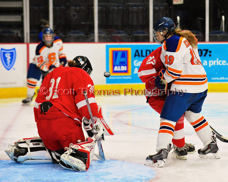 Syracuse University Orange Margot Scharfe (19) looks for a rebound on save by Cornell Big Red goalie Paula Voorheis (31) in NCAA Women Ice Hockey action at the Onondaga County War Memorial on Tuesday, December 3, 2013.
