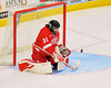 Cornell Big Red goalie Paula Voorheis (31) makes a stick save on a shot by a Syracuse University Orange player in NCAA Women Ice Hockey action at the Onondaga County War Memorial on Tuesday, December 3, 2013.