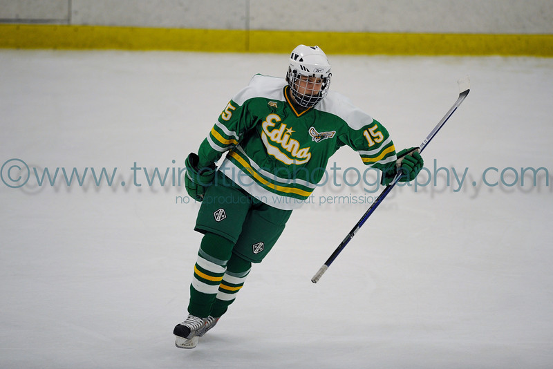 """<font size=""""3"""" face=""""Verdana"""" font color=""""turquoise"""">Edina High School Varsity Hockey vs. Benilde St. Margaret's Boys Hockey Team. January 2009</font> <font size=""""2"""" face=""""Verdana"""" font color=""""white"""">Order a photo print of any photo by clicking the 'Buy' link above.</font><br> <font size = """"2"""" font color = """"gray""""> TIP: Click the photo above to display a larger size</font>"""