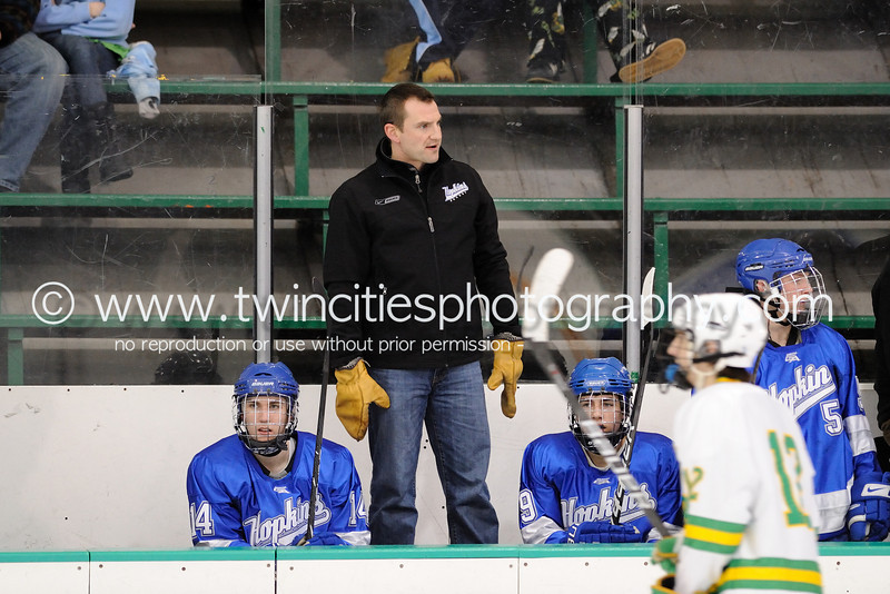 """<font size=""""4"""" face=""""Verdana"""" font color=""""white"""">HEAD COACH CHAD NYBERG</font><p> <font size=""""2"""" face=""""Verdana"""" font color=""""turquoise"""">Edina Hornets vs. Hopkins Royals Varsity Boys Hockey</font><p> <font size=""""2"""" face=""""Verdana"""" font color=""""white"""">Order a photo print of any photo by clicking the 'Buy' link above.</font>  <font size = """"2"""" font color = """"gray""""><br> TIP: Click the photo above to display a larger size</font><p> <font size=""""2"""" face=""""Verdana"""" font color=""""white""""><a href=""""http://twincitiesphotography.info/2010/01/28/edina-hornets-vs-hopkins-royals-varsity-and-junior-varsity-boys-hockey/"""" target=""""_blank"""">Learn more about the images from this game</a></font>"""
