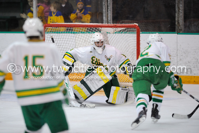 """<font size=""""4"""" face=""""Verdana"""" font color=""""white"""">#30 JOHN ANKENY</font><p> <font size=""""2"""" face=""""Verdana"""" font color=""""turquoise"""">Edina Hornets vs. Hopkins Royals Varsity Boys Hockey</font><p> <font size=""""2"""" face=""""Verdana"""" font color=""""white"""">Order a photo print of any photo by clicking the 'Buy' link above.</font>  <font size = """"2"""" font color = """"gray""""><br> TIP: Click the photo above to display a larger size</font><p> <font size=""""2"""" face=""""Verdana"""" font color=""""white""""><a href=""""http://twincitiesphotography.info/2010/01/28/edina-hornets-vs-hopkins-royals-varsity-and-junior-varsity-boys-hockey/"""" target=""""_blank"""">Learn more about the images from this game</a></font>"""