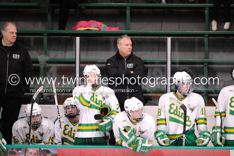 """<font size=""""4"""" face=""""Verdana"""" font color=""""white"""">HEAD COACH CURT GILES</font><p> <font size=""""2"""" face=""""Verdana"""" font color=""""turquoise"""">Edina Hornets vs. Hopkins Royals Varsity Boys Hockey</font><p> <font size=""""2"""" face=""""Verdana"""" font color=""""white"""">Order a photo print of any photo by clicking the 'Buy' link above.</font>  <font size = """"2"""" font color = """"gray""""><br> TIP: Click the photo above to display a larger size</font><p> <font size=""""2"""" face=""""Verdana"""" font color=""""white""""><a href=""""http://twincitiesphotography.info/2010/01/28/edina-hornets-vs-hopkins-royals-varsity-and-junior-varsity-boys-hockey/"""" target=""""_blank"""">Learn more about the images from this game</a></font>"""