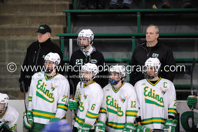 """<font size=""""4"""" face=""""Verdana"""" font color=""""white"""">COACH DICK BLOOSTON (LEFT)<BR>COACH DAVE LANGEVIN (RIGHT)</font><p> <font size=""""2"""" face=""""Verdana"""" font color=""""turquoise"""">Edina Hornets vs. Hopkins Royals Varsity Boys Hockey</font><p> <font size=""""2"""" face=""""Verdana"""" font color=""""white"""">Order a photo print of any photo by clicking the 'Buy' link above.</font>  <font size = """"2"""" font color = """"gray""""><br> TIP: Click the photo above to display a larger size</font><p> <font size=""""2"""" face=""""Verdana"""" font color=""""white""""><a href=""""http://twincitiesphotography.info/2010/01/28/edina-hornets-vs-hopkins-royals-varsity-and-junior-varsity-boys-hockey/"""" target=""""_blank"""">Learn more about the images from this game</a></font>"""