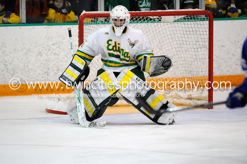 """<font size=""""4"""" face=""""Verdana"""" font color=""""white"""">#1 CONNOR GIRARD</font><p> <font size=""""2"""" face=""""Verdana"""" font color=""""turquoise"""">Edina Hornets vs. Hopkins Royals Varsity Boys Hockey</font><p> <font size=""""2"""" face=""""Verdana"""" font color=""""white"""">Order a photo print of any photo by clicking the 'Buy' link above.</font>  <font size = """"2"""" font color = """"gray""""><br> TIP: Click the photo above to display a larger size</font><p> <font size=""""2"""" face=""""Verdana"""" font color=""""white""""><a href=""""http://twincitiesphotography.info/2010/01/28/edina-hornets-vs-hopkins-royals-varsity-and-junior-varsity-boys-hockey/"""" target=""""_blank"""">Learn more about the images from this game</a></font>"""