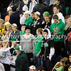 """<font size=""""4"""" face=""""Verdana"""" font color=""""white"""">EDINA STUDENT HOCKEY FANS</font><p> <font size=""""2"""" face=""""Verdana"""" font color=""""turquoise"""">Edina Hornets vs. Bloomington Jefferson Jaguars - Section 2AA State Finals</font><p> <font size=""""2"""" face=""""Verdana"""" font color=""""white"""">Order a photo print of any photo by clicking the 'Buy' link above.</font>  <font size = """"2"""" font color = """"gray""""><br> TIP: Click the photo above to display a larger size</font><p> <font size=""""2"""" face=""""Verdana"""" font color=""""white""""><a href=""""http://twincitiesphotography.info/2010/03/03/section-2aa-play-offs-final/"""" target=""""_blank"""">Learn more about the images from this game</a></font>"""