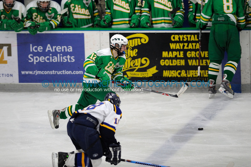 """<font size=""""3"""" face=""""Verdana"""" font color=""""turquoise"""">Edina High School Hockey vs. Wayzata High School Trojans Boys Hockey Team. January 22, 2009</font> <font size=""""2"""" face=""""Verdana"""" font color=""""white"""">Order a photo print of any photo by clicking the 'Buy' link above.</font><br> <font size = """"2"""" font color = """"gray""""> TIP: Click the photo above to display a larger size</font>"""