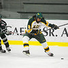 Plymouth State's Erik Strom defends as Fitchburg State's Nat Rojas brings the puck down the ice during Thursday's game.<br /> SENTINEL & ENTERPRISE / BRETT CRAWFORD