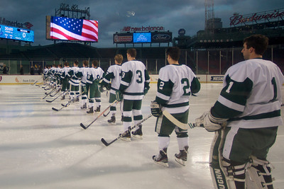 Jan. 13, 2012, Boston, MA -  The Babson College Beavers stand at attention during the singing of the US National Anthem at the Frozen Fenway game against Norwich University. By Ryan Hutton