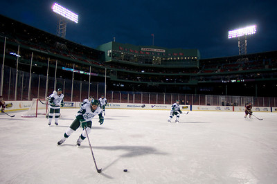 Jan. 13, 2012, Boston, MA - Babson College sophomore Connor Berto clears the puck from behind the Beavers' net during the teams Frozen Fenway game against Norwich University. By Ryan Hutton
