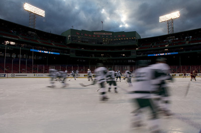 Jan. 13, 2012, Boston, MA - The Babson College Beavers warm up on the ice covering the Fenway Park infield prior to the team's Frozen Fenway game against Norwich University. By Ryan Hutton