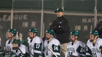 Jan. 13, 2012, Boston, MA - The players and coaching staff of the Babson College mens' ice hockey team look on as the Beavers lose 4-1 to the Norwich University Cadets late in the third period during their Frozen Fenway game. By Ryan Hutton