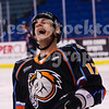Jeff Pierce (17) laughs after a teammate falls on the ice.