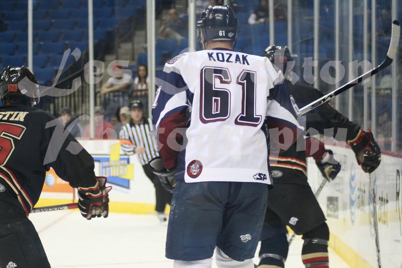 """<a href=""""http://www.hockeydb.com/ihdb/stats/pdisplay.php?pid=71940"""" rel=""""nofollow"""" target=""""stats"""">Rick Kozak</a> (#61)"""