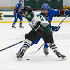 Aaron O'Connor advances the puck between a Grafton defender.<br /> SENTINEL & ENTERPRISE / GARY FOURNIER