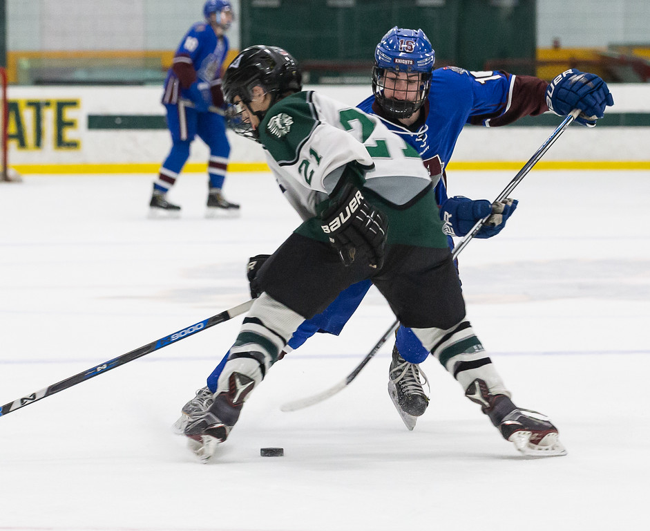 . Aaron O\'Connor advances the puck between a Grafton defender. SENTINEL & ENTERPRISE / GARY FOURNIER
