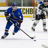 Sean Simpson for moves the puck for Lunenburg.<br /> SENTINEL & ENTERPRISE / GARY FOURNIER